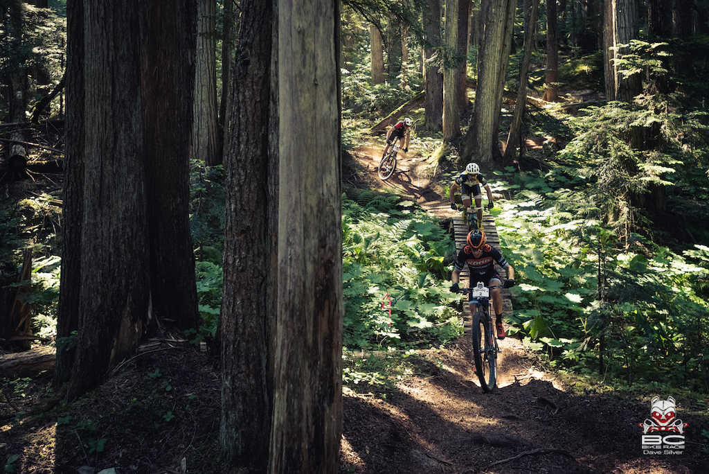 Spencer Paxson leads Tristan Uhl and Quinn Moberg through the deep loam.