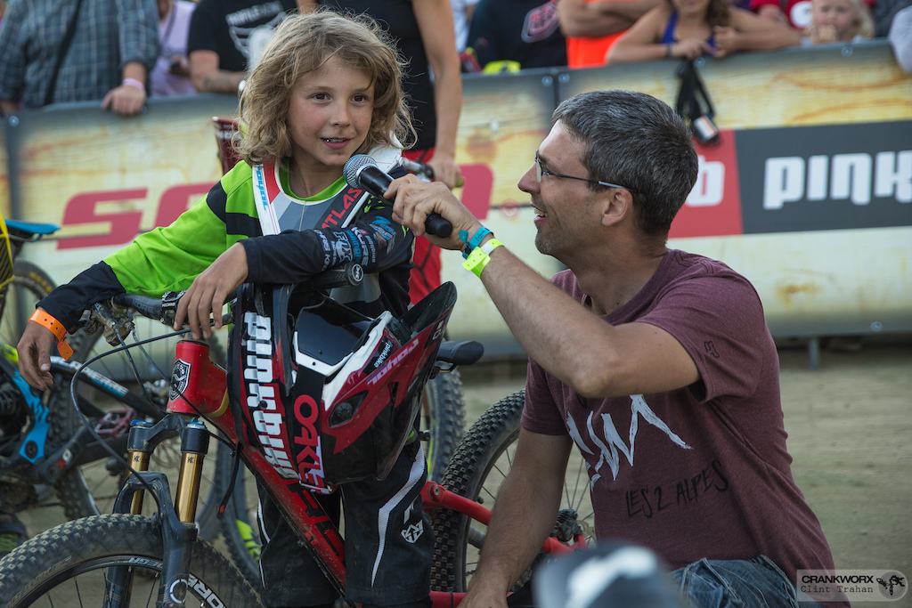 Ten year old Shredder Jackson Goldstone of Canada winner of biggest amplitutde is interviewed for the crowd at Crankworx Les Deux Alpes. Photo by clint trahan crankworx