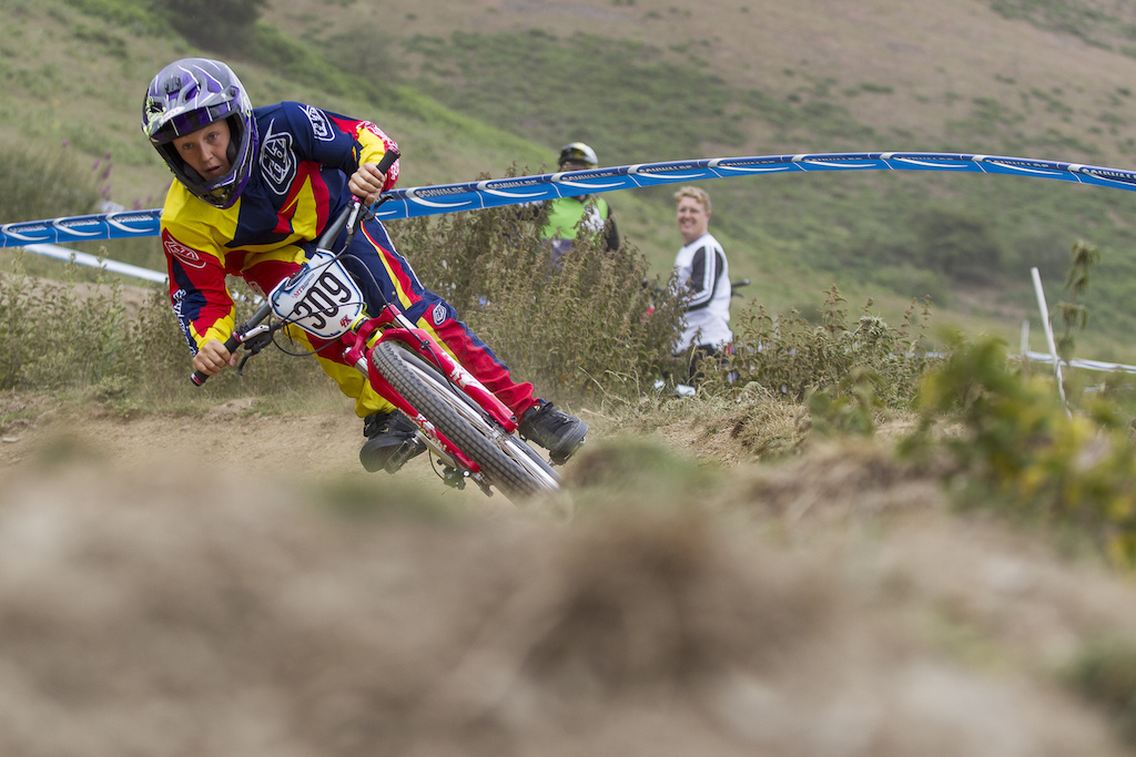 Farther Mark Fernihough watches on as Juvenile rider Harry Fernihough rails a turn during open practice of The Schwalbe British 4X National Championship at Moelfre Hall Moelfre United Kingdom. 11July 2015 Photo Charles Robertson