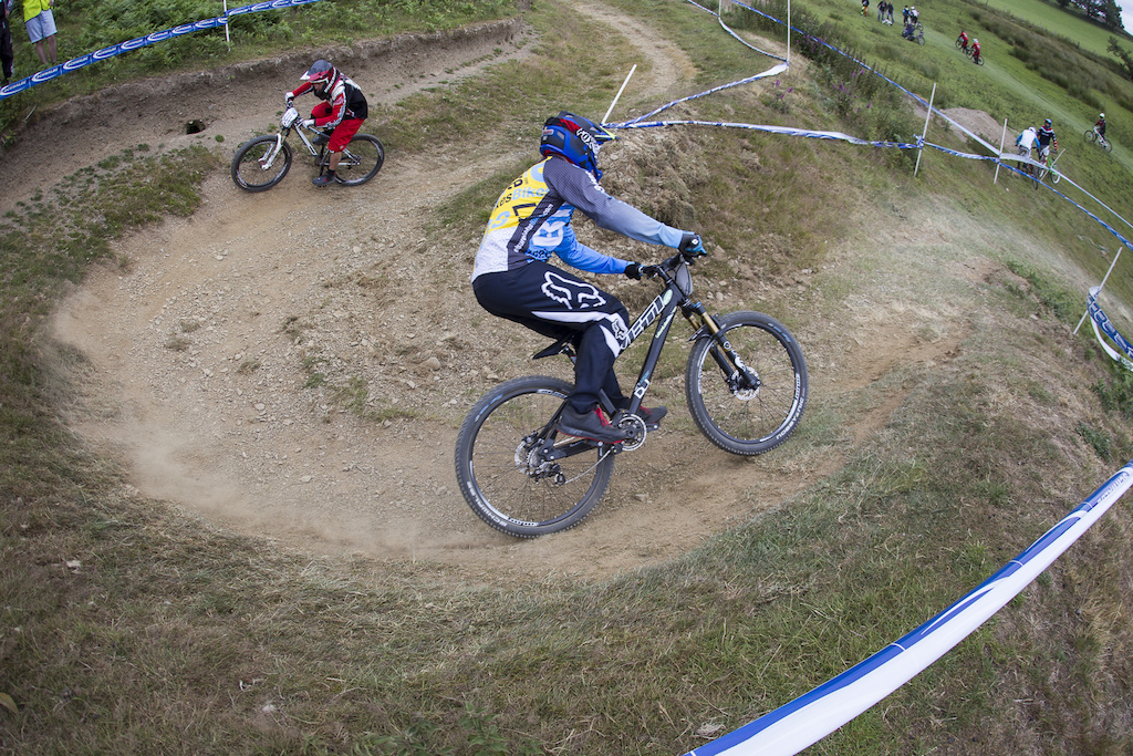 BDS organiser Si Paton follows Leisure Lakes Bikes Dave Richardson into the hairpin to get up to speed during The Schwalbe British 4X National Championship at Moelfre Hall, Moelfre, United Kingdom. 11July,2015 Photo: Charles Robertson