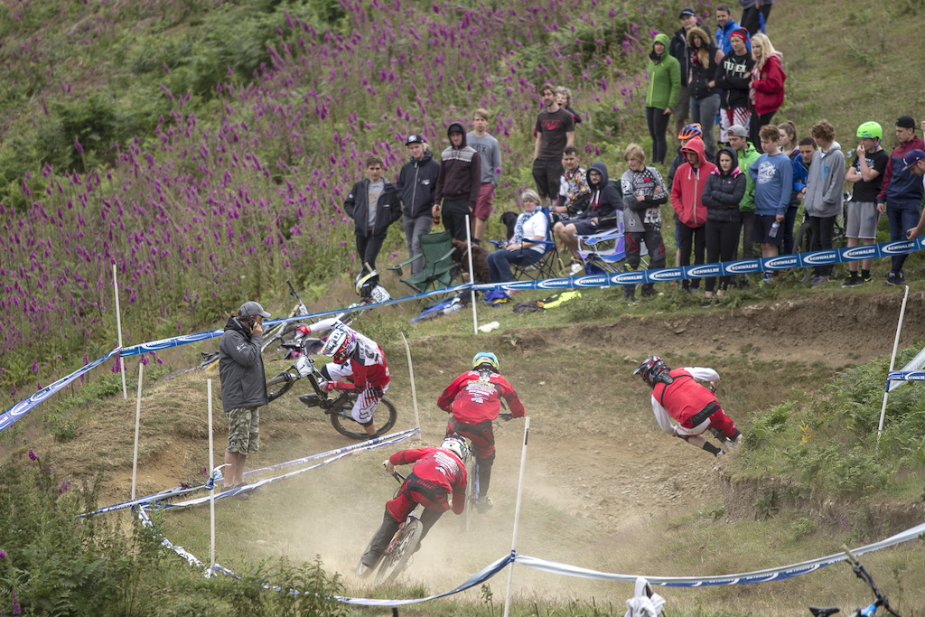 Scott Beaumont leads out Paul Bakewell and the Hudson brothers into the bowl type hairpin during The Schwalbe British 4X National Championship at Moelfre Hall, Moelfre, United Kingdom. 11July,2015 Photo: Charles Robertson