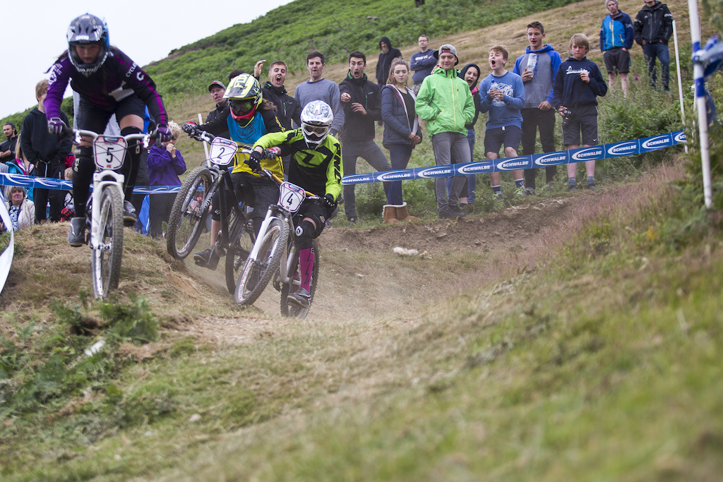 Battling it out bar to bar elbow to elbow to get through to the finals during The Schwalbe British 4X National Championship at Moelfre Hall Moelfre United Kingdom. 11July 2015 Photo Charles Robertson