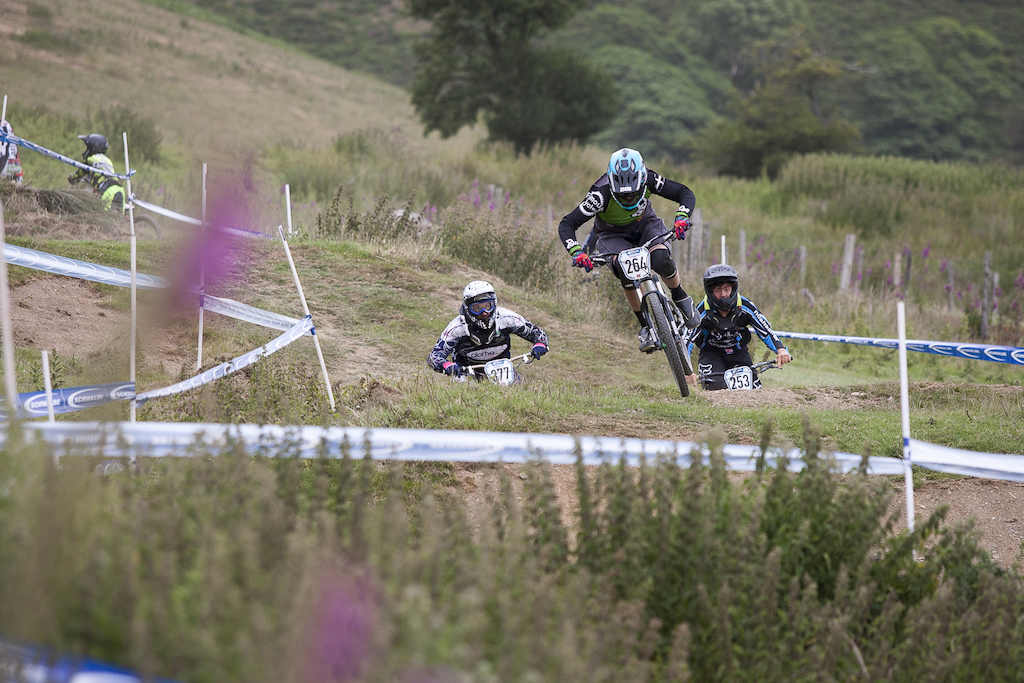 Dirt Bike Supply's Charlie Currie leading into the first turn during The Schwalbe British 4X National Championship at Moelfre Hall, Moelfre, United Kingdom. 11July,2015 Photo: Charles Robertson