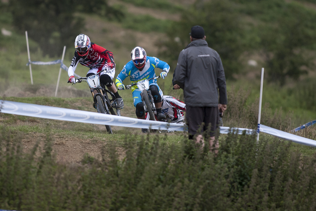 Scott Beaumont and Nate Parsons battle it out in the final with Alex Metcalfe on their back wheel during The Schwalbe British 4X National Championship at Moelfre Hall Moelfre United Kingdom. 11July 2015 Photo Charles Robertson