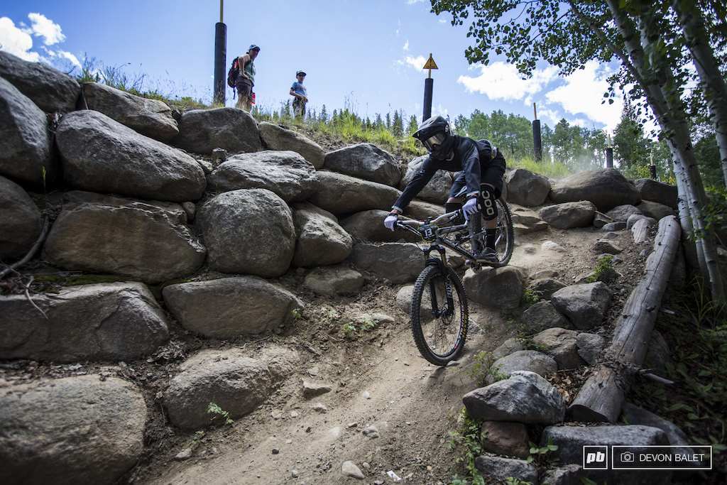 This relatively mellow looking section took down several riders over the weekend. A hidden pedal grabber at the top of the rocks sent a few racers for a ride. Roy Benge demonstrates a clean ride through.