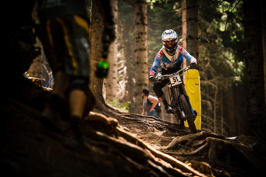 Innes enjoying the sun-spotted and gnarly terrain of Peaty s track in Lenzerheide.