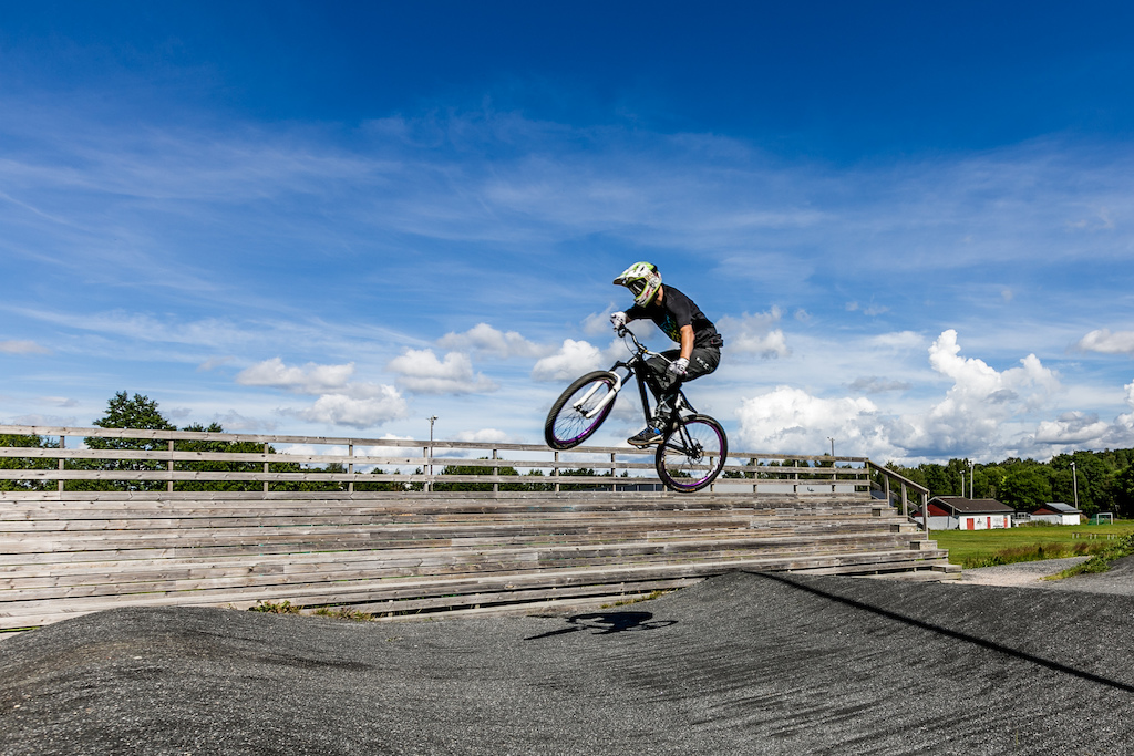 Jumping the third jump on the first line on the local bmx track.