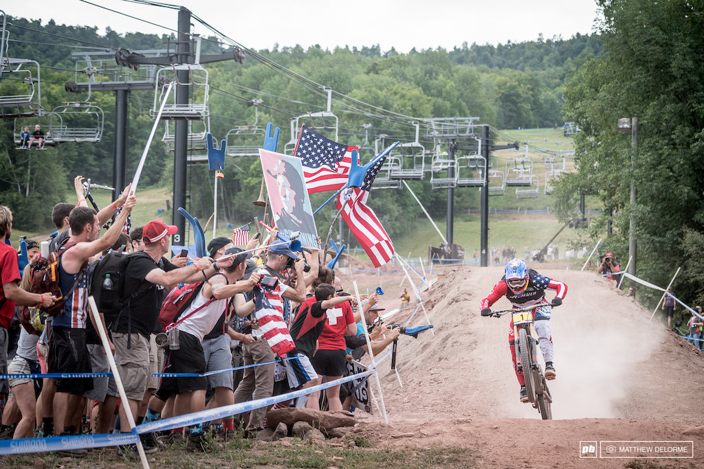 The home crowd cheering Gwin in as he stares down the finish line.
