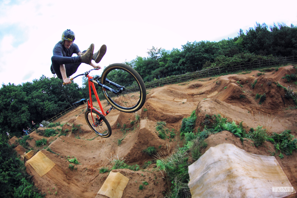 Olly Wilkins going old school with a big Heel Clicker mid-set on the pro line at S4P Bikepark