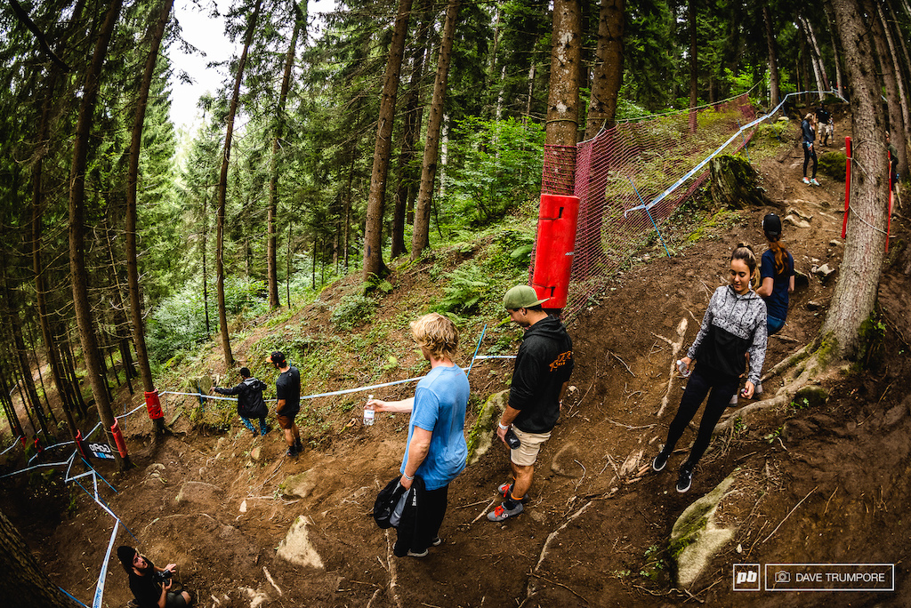 Fresh of his King of Crankworx title Bernard Kerr helps point out the good lines to his friends and teammates.