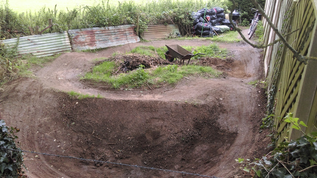 Backyard Pumptrack at my buddy's house. Big plans for this space next summer