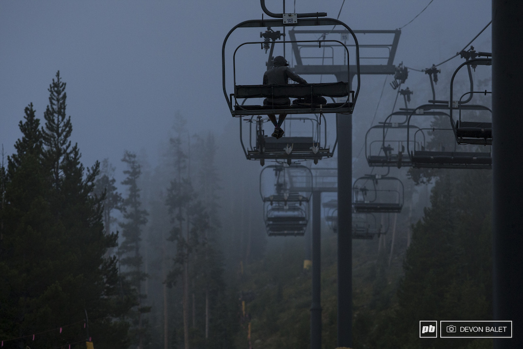 A lone racer rides the lift up into the clouds on Trestle Bike Park.