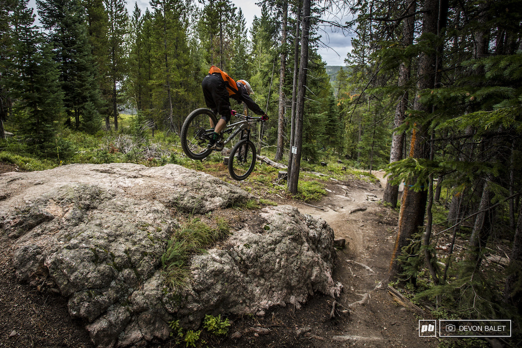 Trestle Bike Park isn t all smooth fast bermed trails. There are a few rocks to be found as well. Scott Countryman goes low and fast over one particularly large rock.
