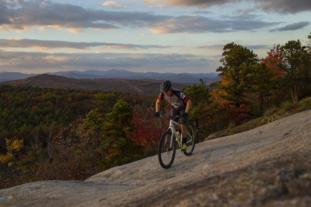 Edge of the cliff at sunset Big Rock Trail DuPont State Forest. Cedar Mountain North Carolina.