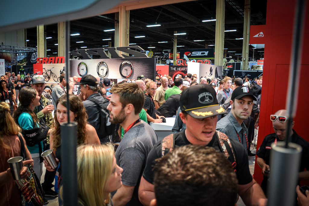 The melee at the SRAM booth. Turns out people like free beer ad free swag.