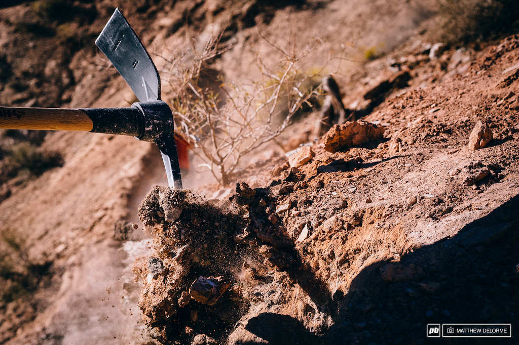 Hard steel smashing through rock and dirt sculpting the perfect line.