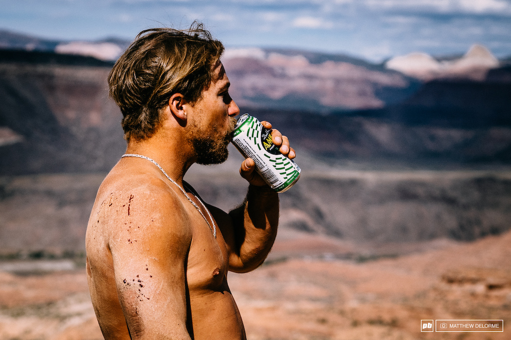 Robbie Bourdon rode shirtless with an open face D2. After he crashed out on his second run he enjoyed the view with a cold brew.