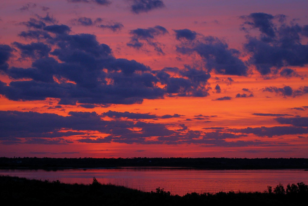 #nofilter. The sunset of Topsail Beach blowing up with some serious color after a long day of steady rain.
