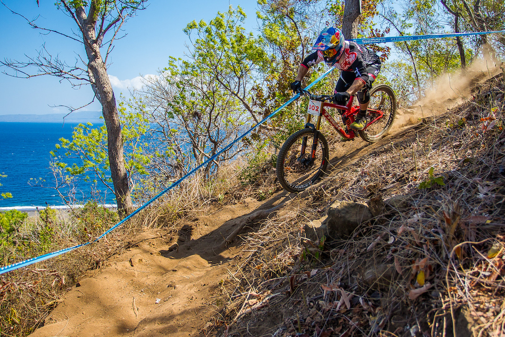 Brook Macdonald heads towards the finish and some legendary Bali surf breaks. His race wouldn t go to plan as he caught a pedal in a straightaway and went over the bars. Then he decided to go all out and yanked at the finish line landing to flat and rolling his bars. Animal.