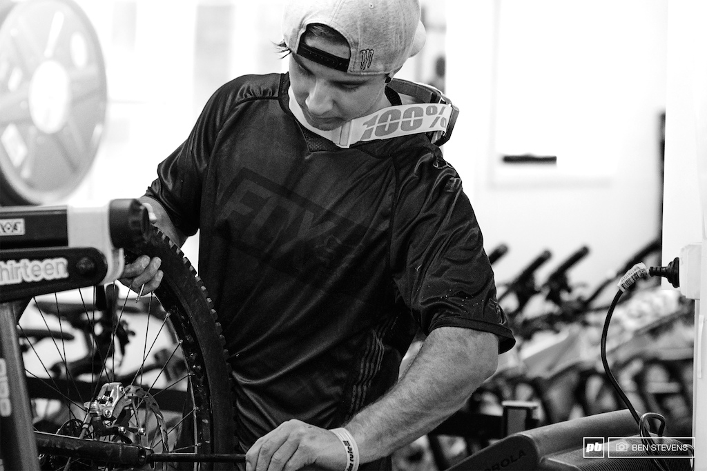 A.Crimmins giving his bike a bit of a tune in the comfort of Thredbo MTB s workshop.