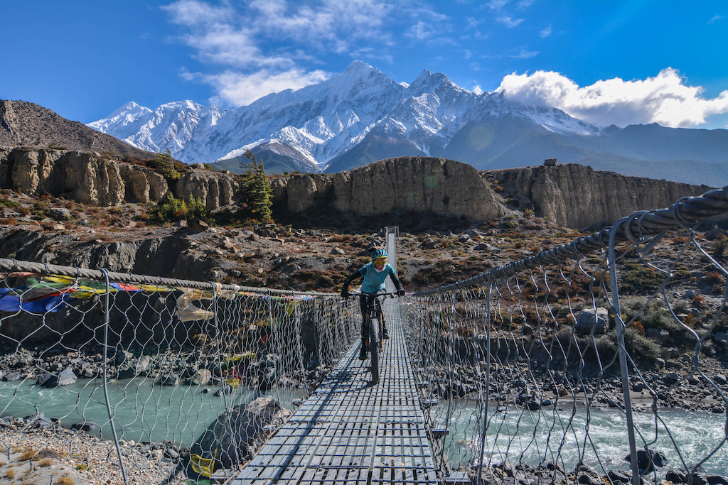 Shanna crossing one of many iconic suspension bridges in Mustang, Nepal. With the Nilgiri peaks behind her
