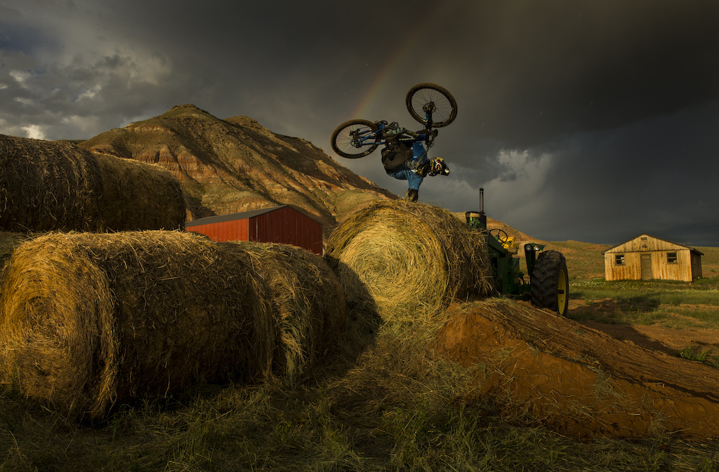 Cam McCaul hand plant amongst the thunder, barns, rain, tractors, rainbows, lightning and firing light on Turtle Ranch, Wyoming during the filming of unReal.