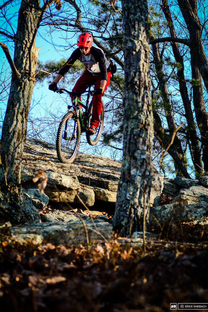 Harlan Price is a very talented rider be it on high speed downhills or terrain like this the type of trail that requires the rider to either nose wheelie his way through a rocky turn or get off the bike and walk. Harlan ain t interested in walking this.