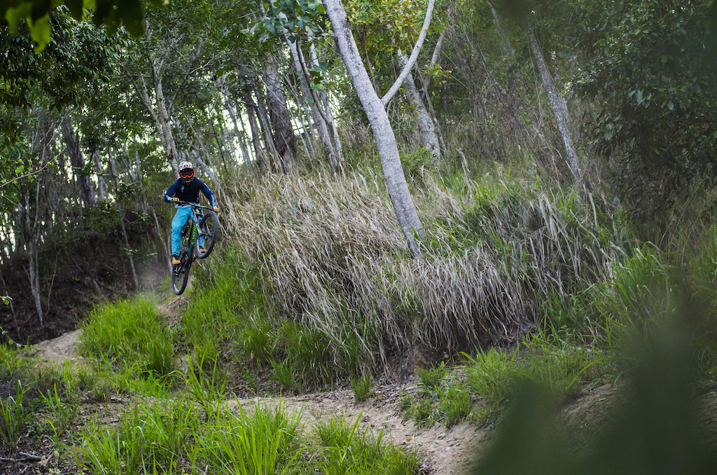 The hills of Cairns grow fast. The enclosing foliage after the busy worn in period of world-cup action in 2014 means the course takes on a far more sinister feel with such a narrow line being left to calculate. Come this April it will be back to race spec once again.
