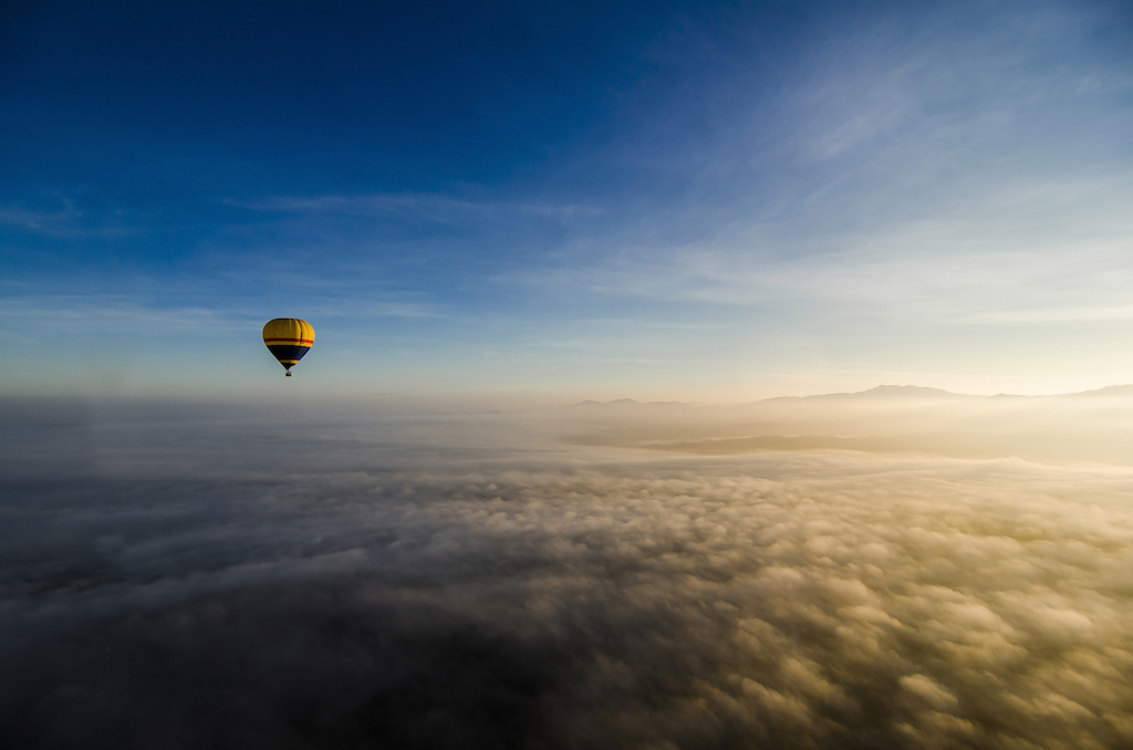 The pilots at Raging Thunder Hot-Air Ballooning must love their job. Troy experienced a rather intimate journey in his tiny 4-man basket in view high above the Great Dividing Range.