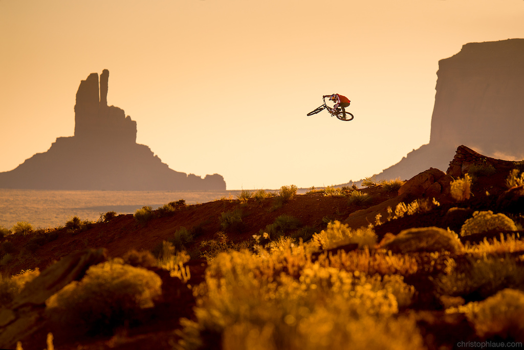 """We shot this picture on our trip to Utah for Red Bull and a German TV show """" Wild Ones - Junge Helden"""". Due to the strict time schedule we had only three hours to build this hip in the afternoon and three hours to shoot the picture in the sunrise the next morning. But the sweat and tears were definitely worth it. It was a special experience for us to take the first freeride shot in Monument Valley. :-)"""