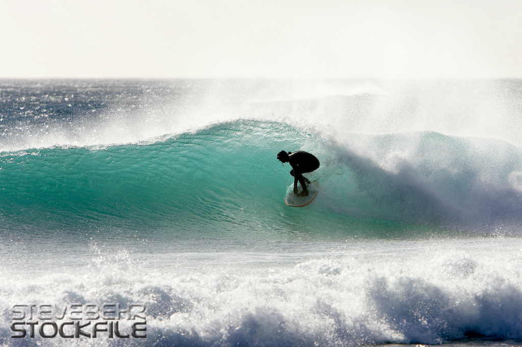 Surfing silhouette Cape Town South Africa . March 2008. Pic copyright Steve Behr Stockfile.