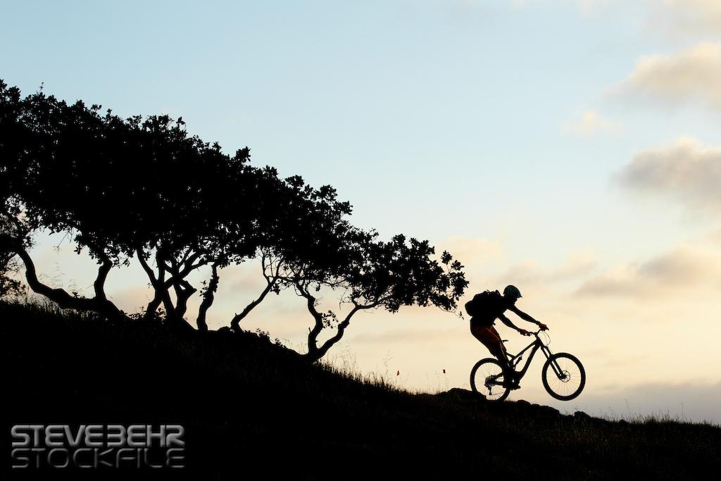 Andrew Dodd Intense custom mtb. Sunset Silhouette Monterey California USA . 2014 pic copyright Steve Behr Stockfile