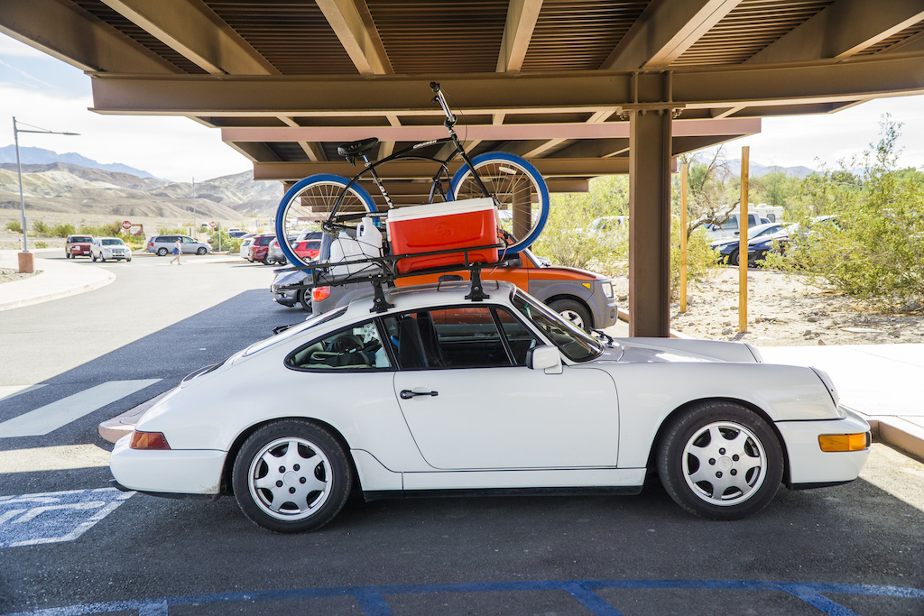 As seen in Death Valley an 80s something Porsche 911 with a Yakima roof rack with all the trimmings.