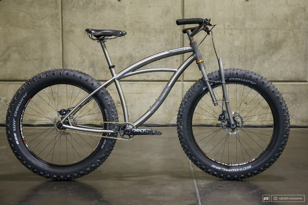 Black Sheep Bikes from Fort Collins Colorado had this 25.6 lb. fat bike with flexing plates in the fork and chainstay yoke. They say the travel is 25-40mm.