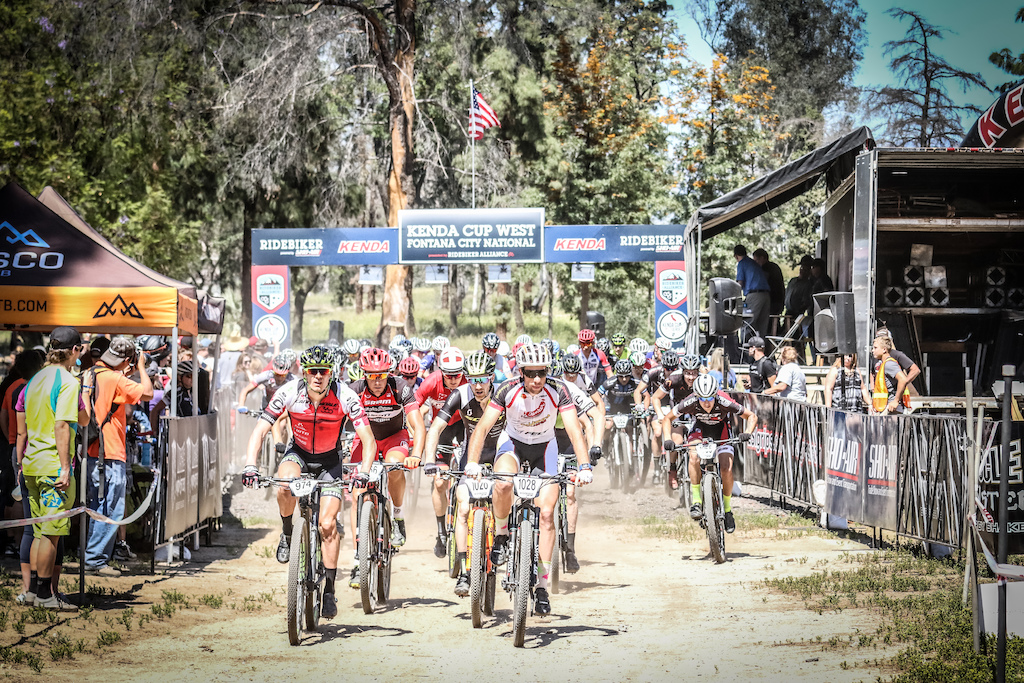 The start of the Men s Pro XC race saw fans lined up and the racers bunched up. Gagne on the left of the photo would stay at the front the entire race.