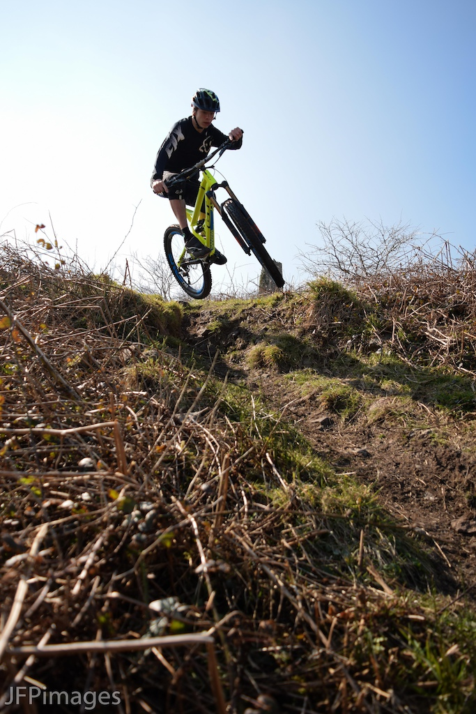 Falmouth Cycles sponsored rider Jake Marsh scrubbing of a drop on the DH track on Rosewall Hill in St.Ives.