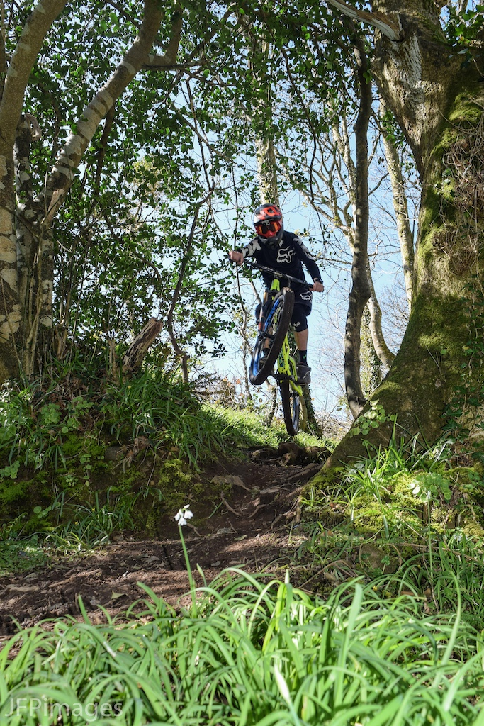 Currently the leader the National Enduro Series and Falmouth Cycles rider Jake Marsh hitting a techy root drop in Tolver Woods.