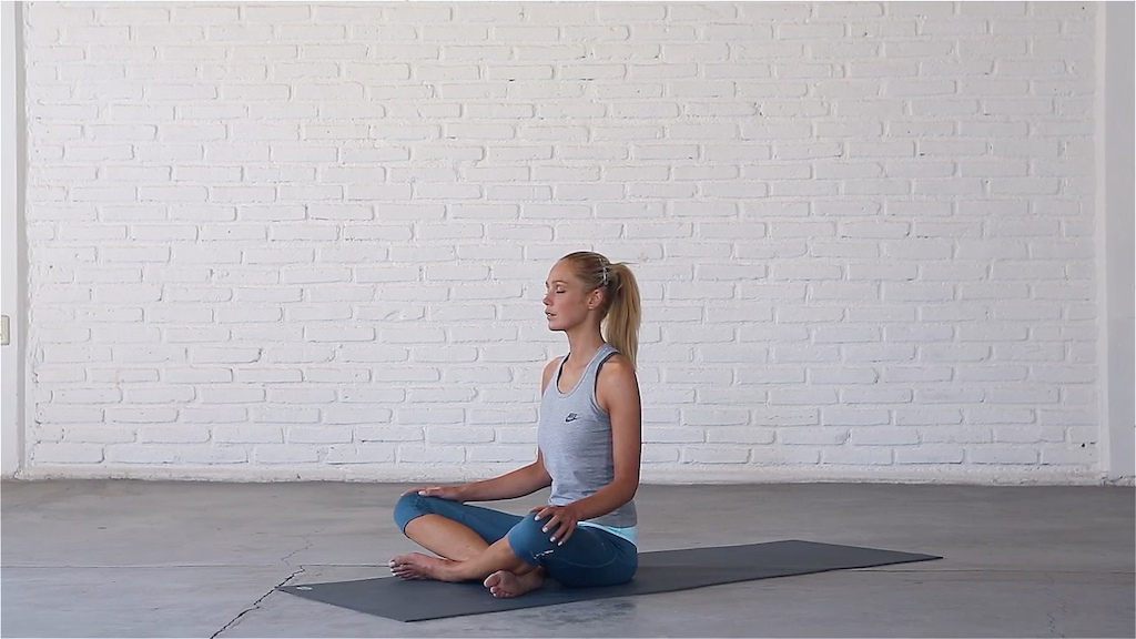 Abi Carver practicing a calming breathing technique.