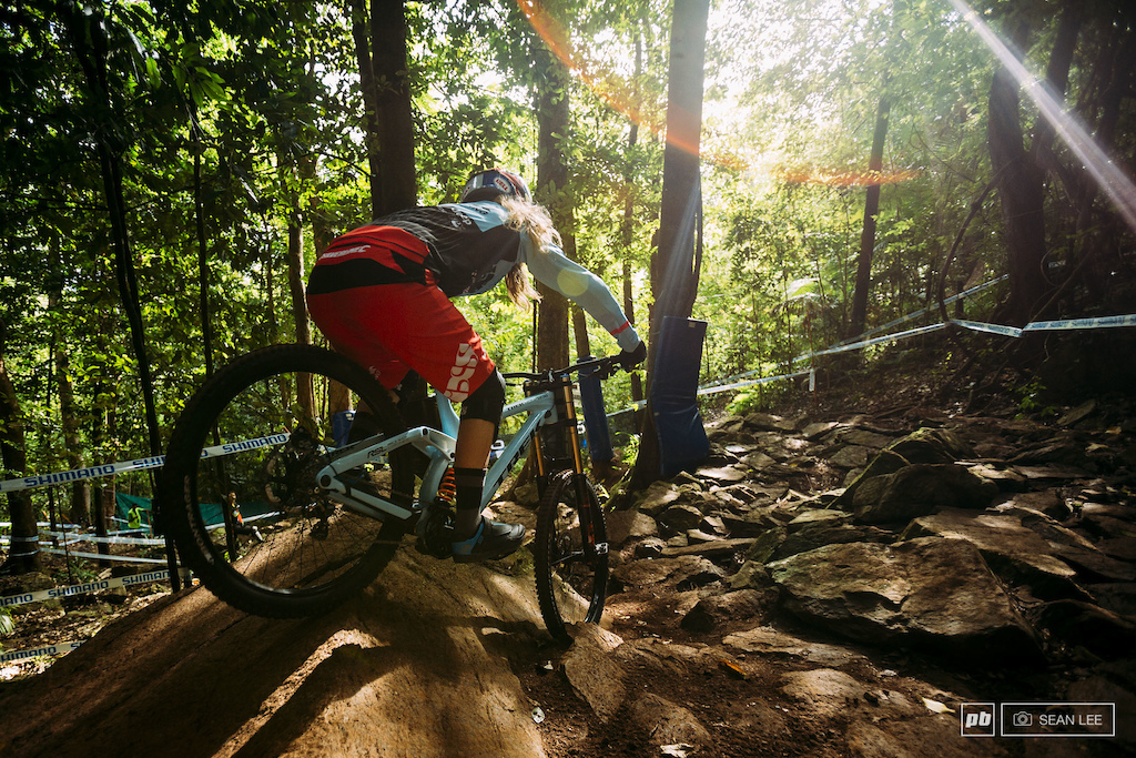 Rachel Atherton drops into the rock garden bright and early for the first run of the week.
