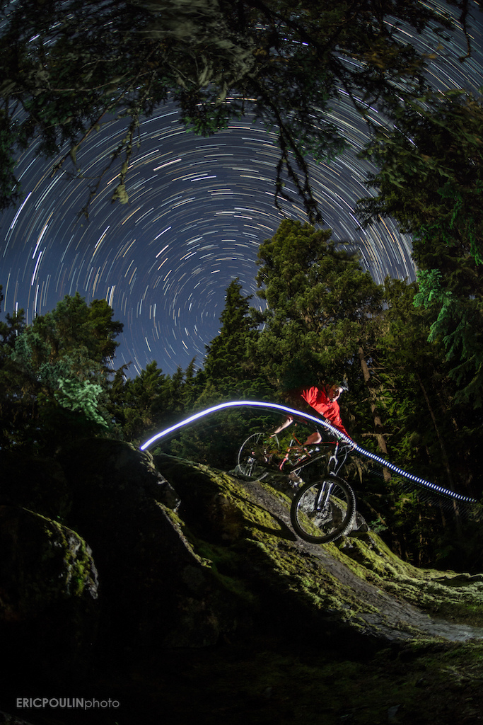 A not-so-common trail in the Stonebridge area in Whistler, I knew this rock roll could look good at night. This is a composite of about 100 images showing the movement of the stars, with Alex riding the rock roll in the first frame.