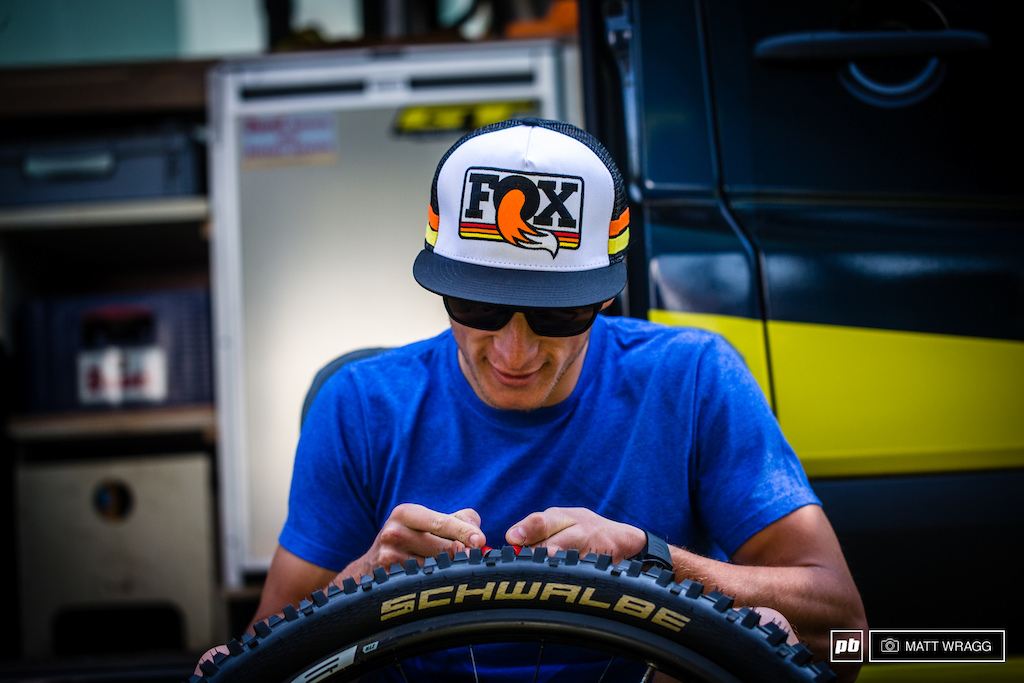With some downtime Martin Maes was quite happy to hang out with his mechanics and cut down his own tyres ready for the race.