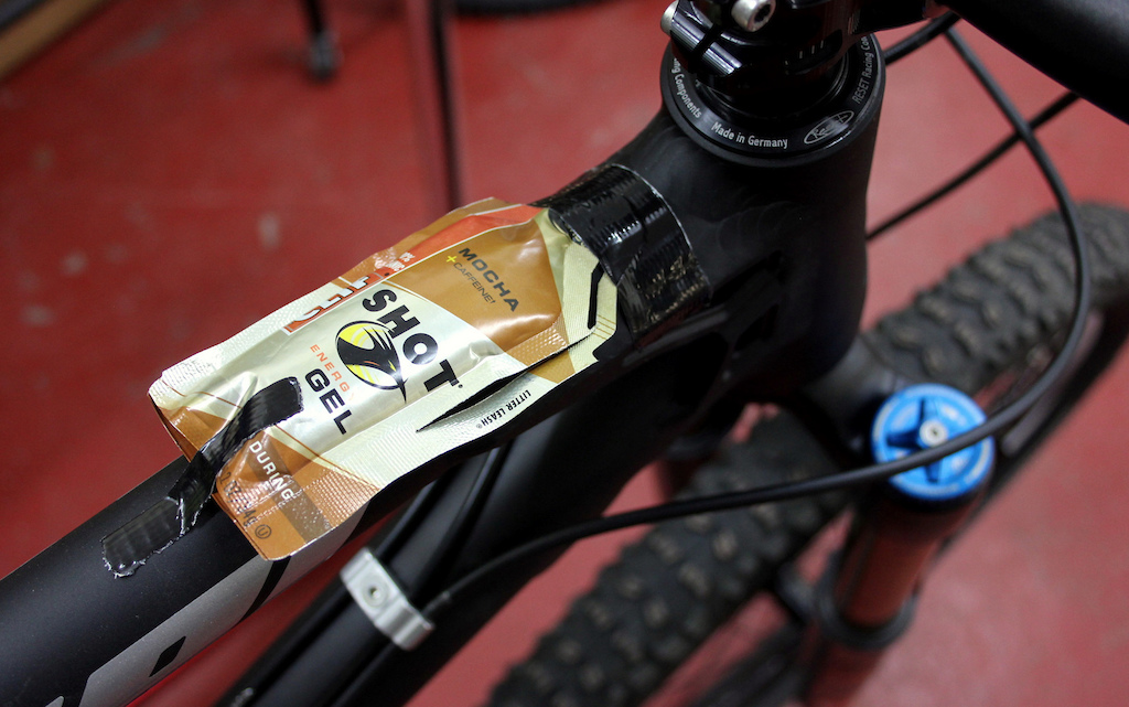 This tip is an old cross-country racer s favorite. Tape the top of the  sachet above the perforated tear line to your bike s top tube. When you get  peckish a49ed2356
