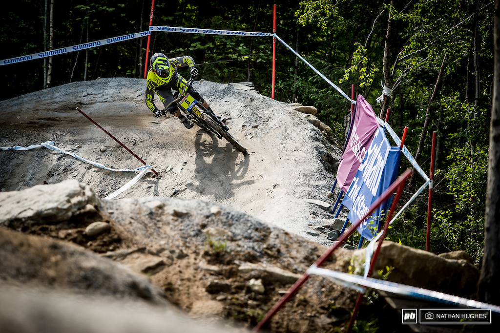 Commencal Riding Addiction s Gaetan Vige charging the big berm for eighth and ready to push harder tomorrow
