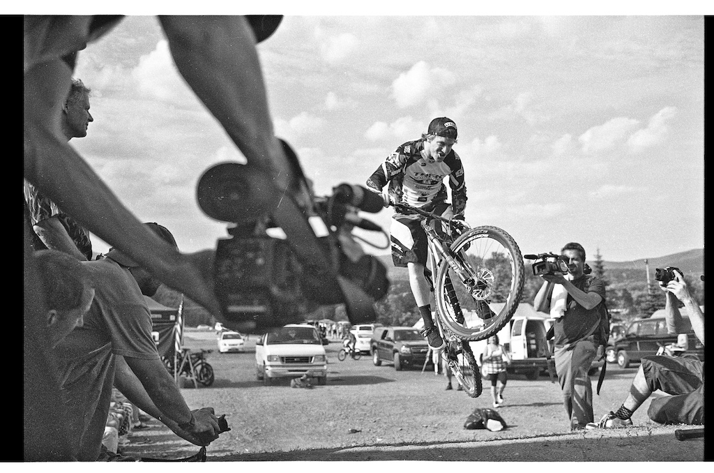 A little bank between the pits and the parking was used as a kicker for the best trick contest. Aaron Gwin trying to pull a whip. Shot with LEICA M6 / 35mm f/1.4 Summilux