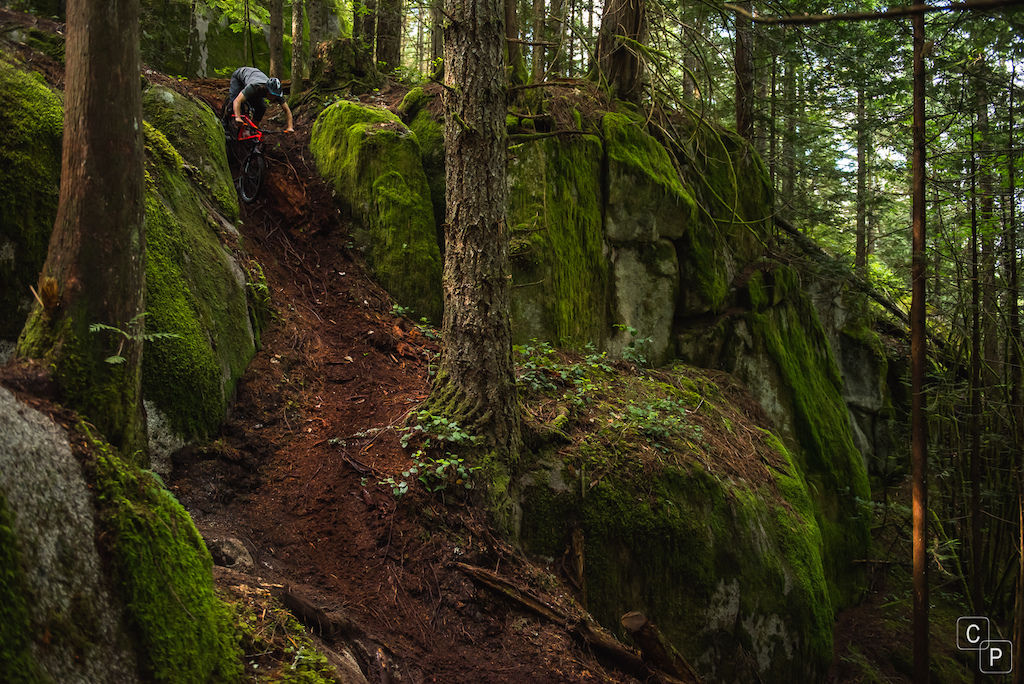 Jordan drops in to a loamy chute on his Chromag Stylus.