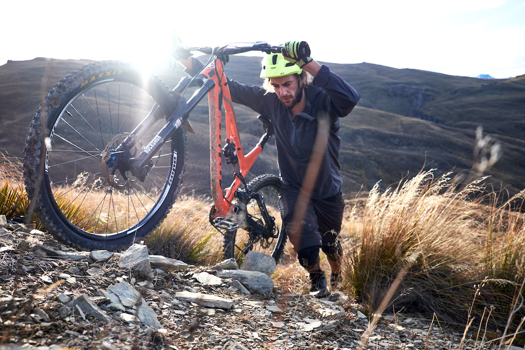 You've gotta go up to go down. Riding amongst in the high alpine above Lake Hawea.