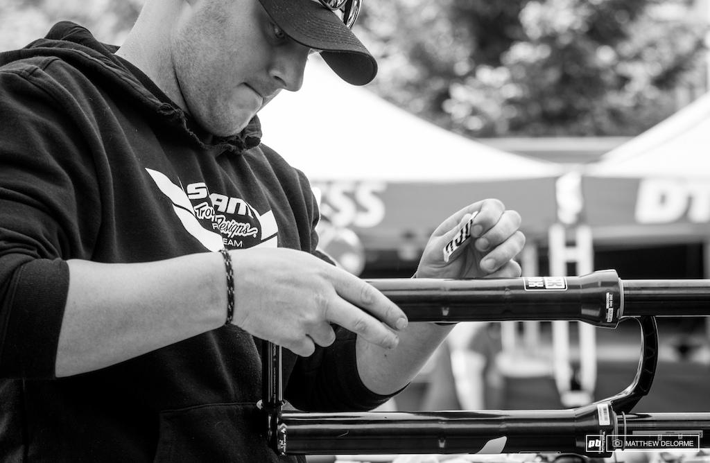 Evan Warner putting fresh decals on Troy s fork.