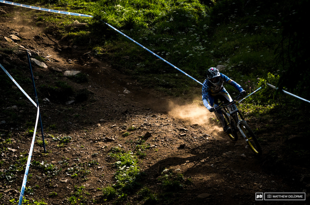 Mike Jones running through light and shadow to a fourth place qualification result.