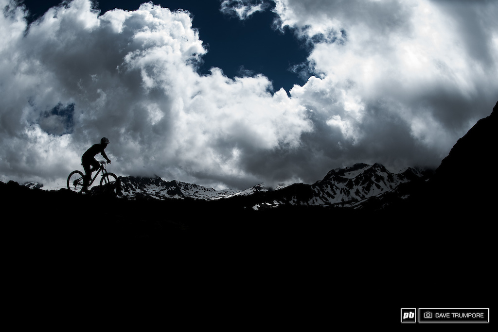 Matthew Delorme silhouetted against some dynamic skies on Stage 5.