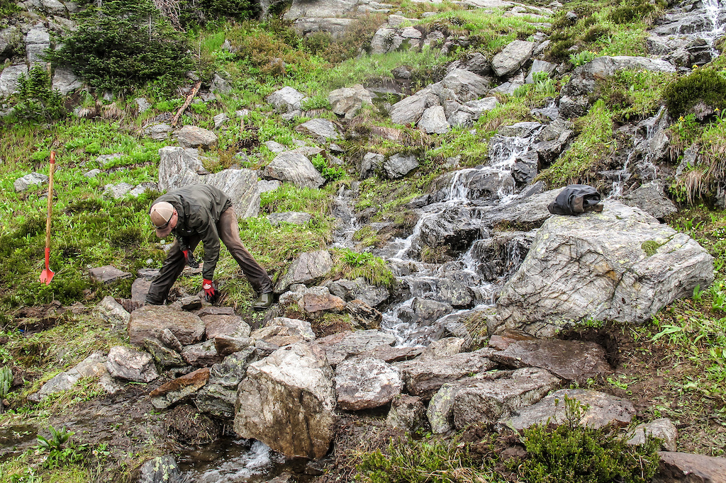 It's a labour intensive process building trails in the alpine but the effort is needed to build sustainable trails.  Marc Reimer laying rocks on the South Caribou Pass trail.